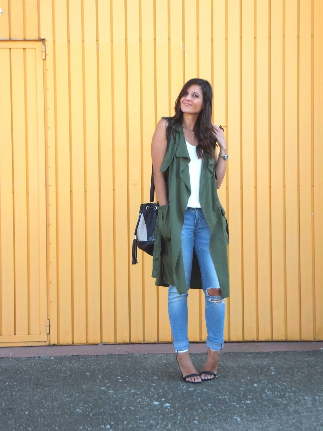 fashion blogger wearing green vest